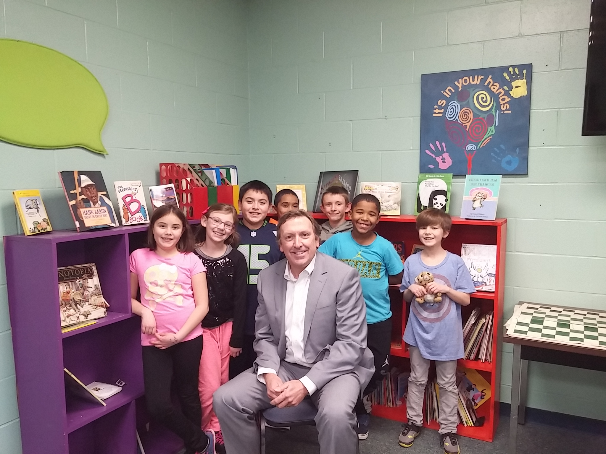 Erik Dyrland with some kids at the Boys and Girls Club on Kentucky Street. photo: Jeff Judkins