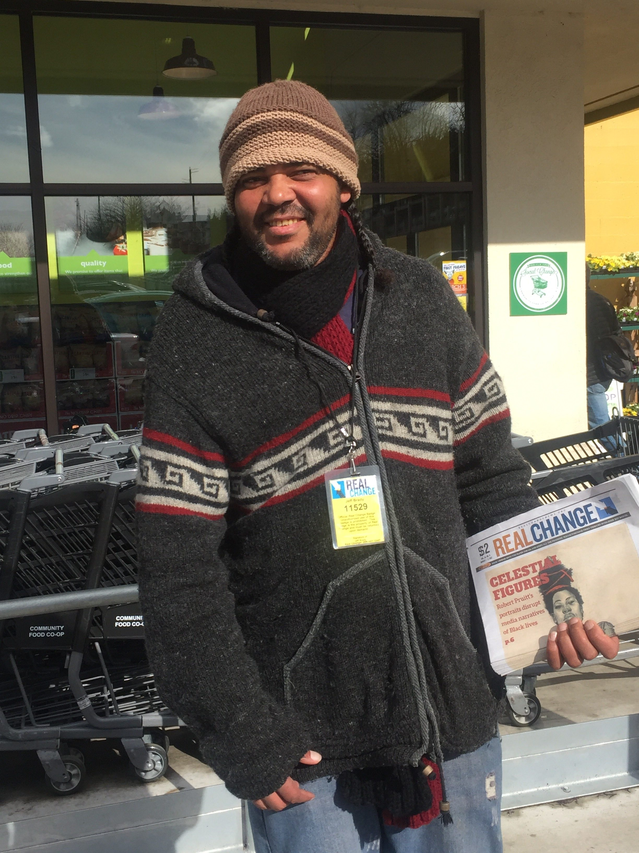 Jeremiah Crowder, longtime vendor, sells Real Change news outside the downtown Community Food Co-op. photo: Becky Spithill