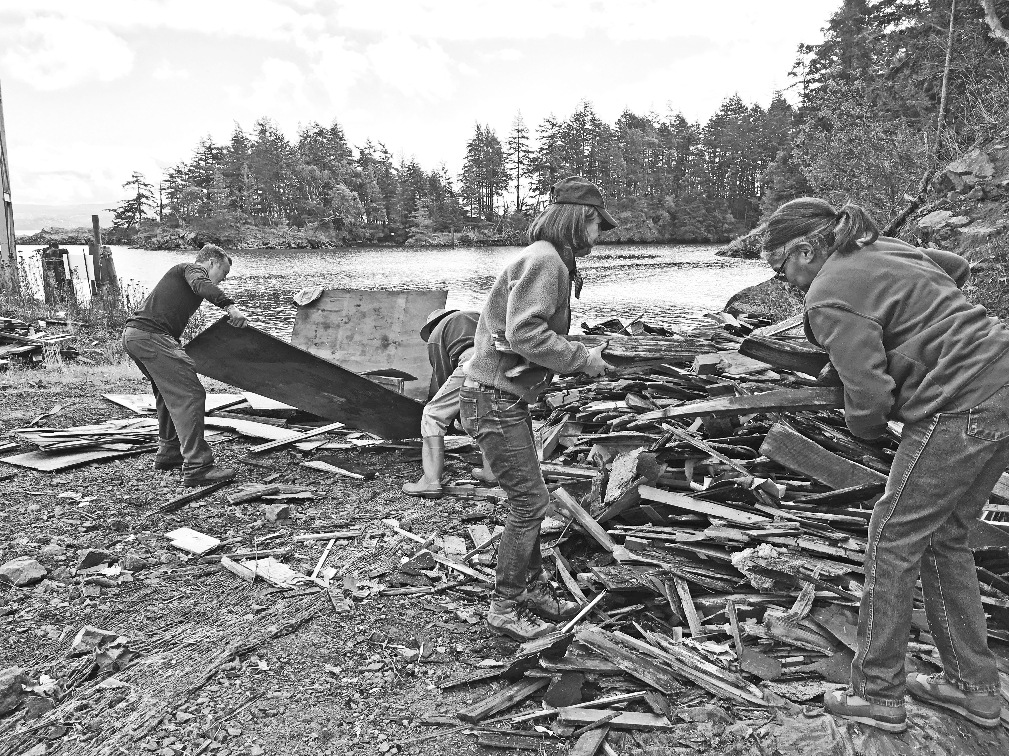 Lummi Island Heritage Trust volunteers sort debris on the shoreline of the Aiston Preserve, once an active rock quarry on the eastern shoreline of Lummi Island. Restoration is underway and in the future the 105 acre Aiston Preserve will become a nature preserve with access from the water for small boats. Visitors will be able to enjoy low impact recreation such as hiking and bird watching. photo: Lummi Island Heritage Trust